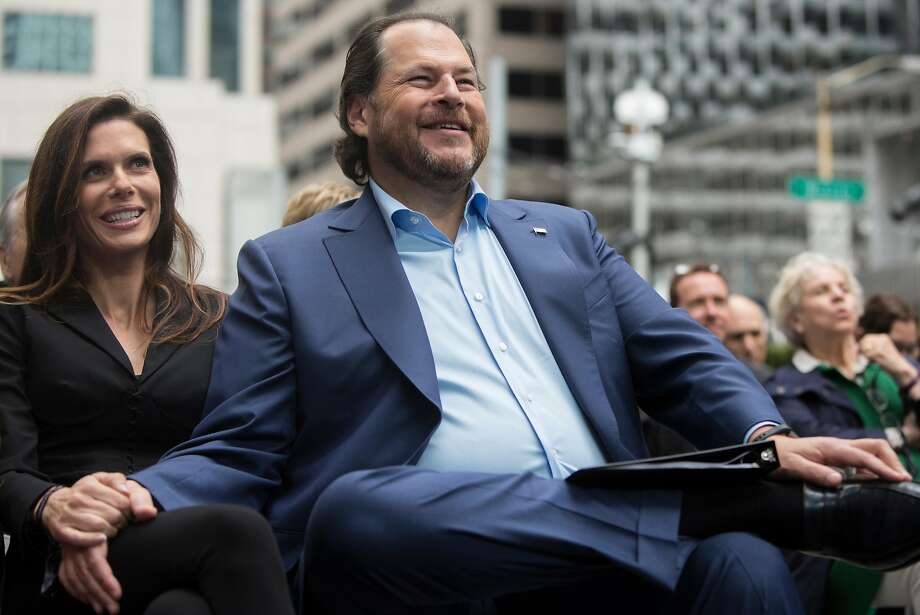 Salesforce CEO Marc Benioff laughs with his wife Lynne Benioff during the grand opening ceremony of the Salesforce Tower in San Francisco, Calif. Tuesday, May 22, 2018. Photo: Jessica Christian / The Chronicle