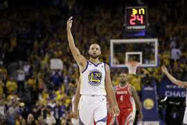 Golden State Warriors guard Stephen Curry (30) gestures against the Houston Rockets during Game 3 of the NBA basketball Western Conference Finals in Oakland, Calif., Sunday, May 20, 2018. (AP Photo/Marcio Jose Sanchez)