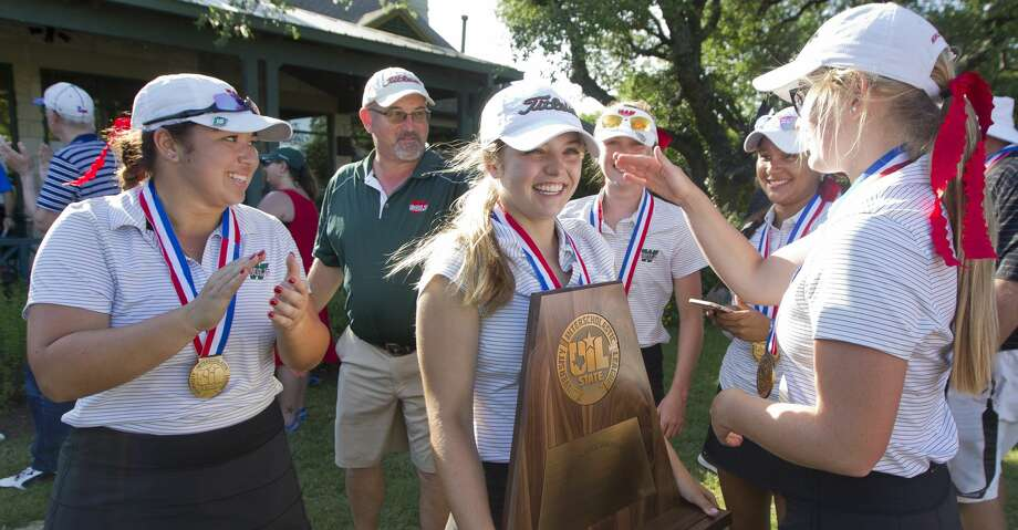 Karina Benavides of The Woodlands, center, reacts after the Lady Highlanders finished third overall in the Class 6A UIL State Golf Championships at Legacy Hills Golf Club, Tuesday, May 22, 2018, in Georgetown. Photo: Jason Fochtman/Houston Chronicle