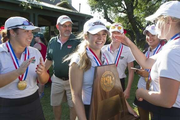 Karina Benavides of The Woodlands, center, reacts after the Lady Highlanders finished third overall in the Class 6A UIL State Golf Championships at Legacy Hills Golf Club, Tuesday, May 22, 2018, in Georgetown.