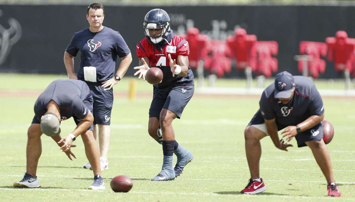 Quarterback Deshaun Watson (center) looks like he's ready to play in a game after undergoing knee surgery seven months ago, but the Texans will be cautious in how they handle him leading up to the season.