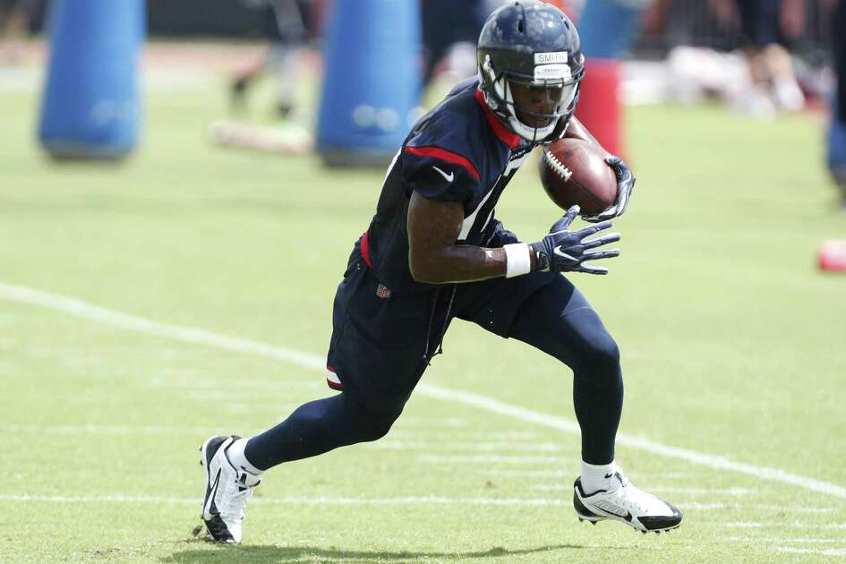 Houston Texans wide receiver Vyncint Smith (17) runs upfield after making a catch on the sidelines during Organized Team Activities at The Methodist Training Center on Tuesday, May 22, 2018, in Houston. ( Brett Coomer / Houston Chronicle )