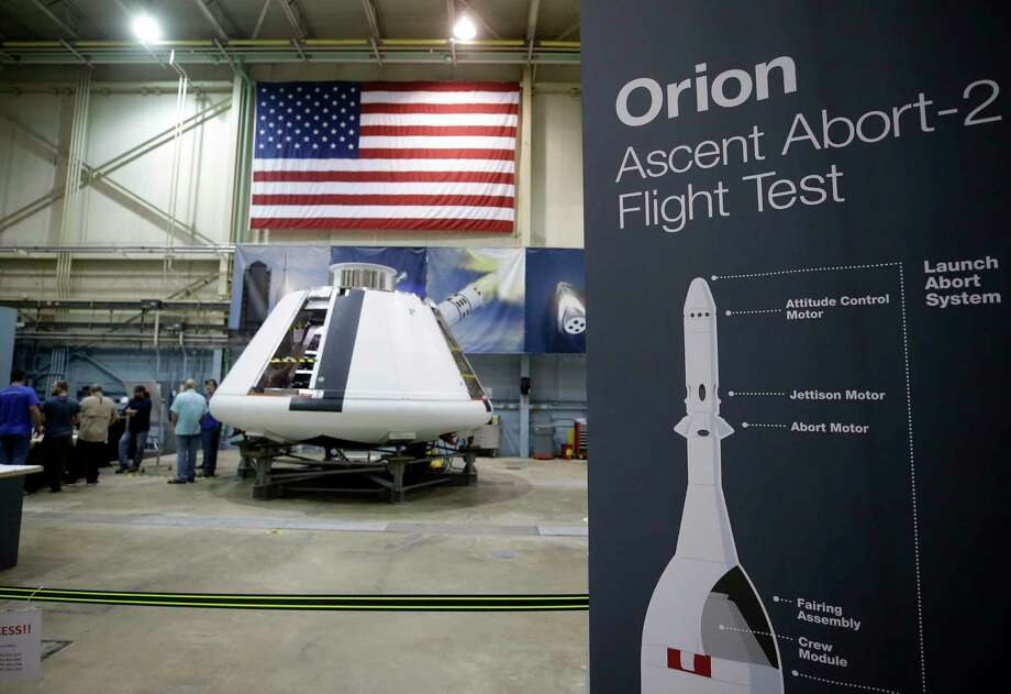 Personnel are shown at NASA's Johnson Space Center working on the Orion Spacecraft launch abort system Friday, April 13, 2018, in Houston. Photo: Melissa Phillip, Staff / Houston Chronicle / © 2018 Houston Chronicle