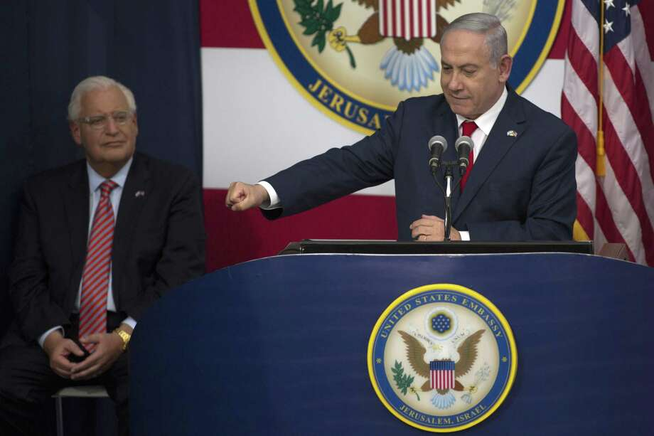 Israel's Prime Minister Benjamin Netanyahu speaks on stage as U.S. ambassador to Israel David Friedman (L) looks on during the opening of the US embassy in Jerusalem on May 14, 2018 in Jerusalem, Israel. US President Donald J. Trump's administration officially transfered the ambassador's offices to the consulate building and temporarily use it as the new US Embassy in Jerusalem. Trump in December last year recognized Jerusalem as Israel's capital and announced an embassy move from Tel Aviv, prompting protests in the occupied Palestinian territories and several Muslim-majority countries. Photo: Lior Mizrahi, Stringer / Getty Images / 2018 Getty Images