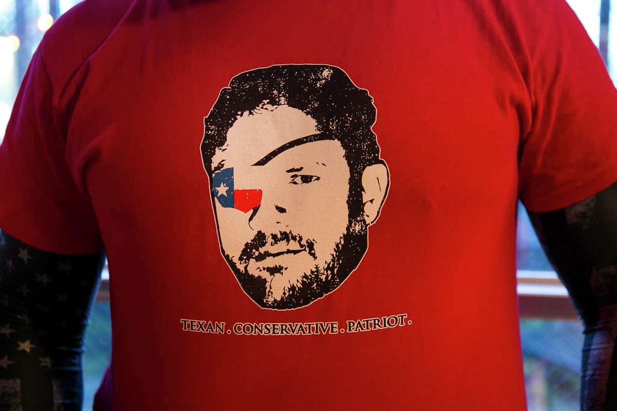 A supporter wears a t-shirt for Republican Dan Crenshaw during an election night party at the Cadillac Bar, Tuesday, May 22, 2018 in Houston. Crenshaw is in a run-off with Kevin Roberts for Texas congressional district 2.