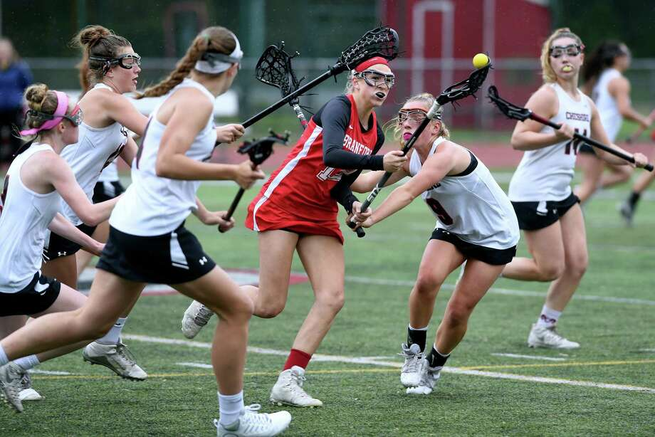 Brianna Shaw (center) of Branford loses the ball as she navigates through Cheshire defenders in an SCC semifinal game in Cheshire on May 22, 2018. Photo: Arnold Gold / Hearst Connecticut Media / New Haven Register