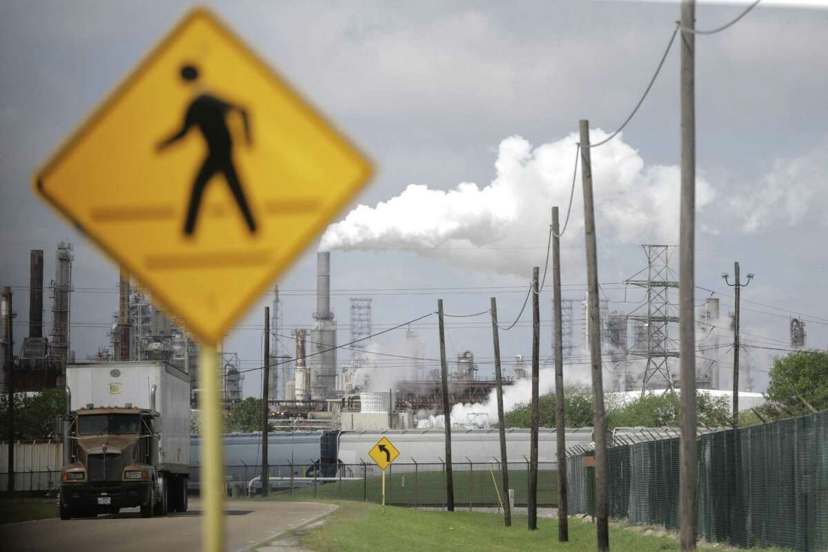 FILE - A pedestrian cross walk near the Shell Deer Park refinery on Thursday, March 29, 2018, in Deer Park, Texas. An increasing number of states have pushed or are considering pushing bills that would put a price on greenhouse gas emissions.
