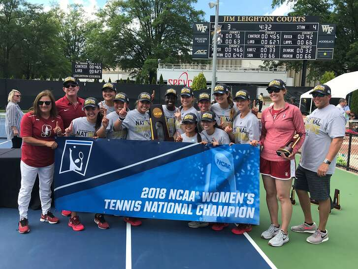 Stanford players and coaches pose with the championship banner after winning the school's 19th women's NCAA tennis title in Winston-Salem, N.C., on Tuesday.