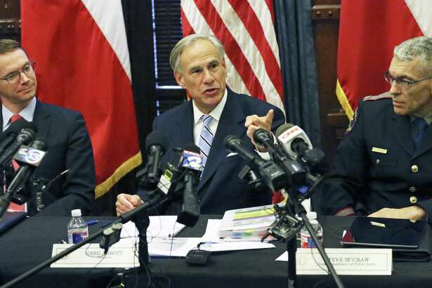Governor Greg Abbott leads a roundtable discussion in his offices on guns in the wake of the Santa Fe shootings on May 22, 2018. Seated near him are Mike Morath (left) of the Texas Education Agency, and Steve McGraw Texas Department of Public Safety.