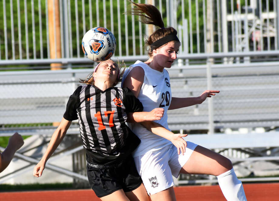 Edwardsville's Megan Bowman, left, and Belleville West's Melanie Kulig battle for a ball in the first half of Tuesday's game.