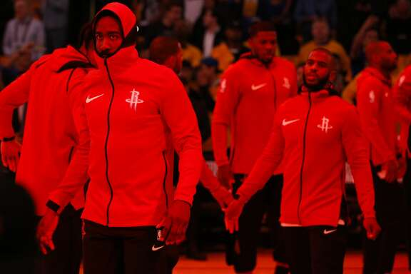 Houston Rockets guards James Harden, left, and Chris Paul walk onto the court during introductions before Game 4 of the Western Conference Finals at Oracle Arena Tuesday, May 22, 2018 in Oakland. (Michael Ciaglo / Houston Chronicle)