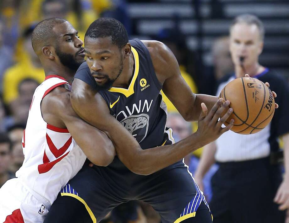 Golden State Warriors forward Kevin Durant (35) is defended by Houston Rockets guard Chris Paul (3) during the first half of Game 4 of the Western Conference Finals at Oracle Arena Tuesday, May 22, 2018 in Oakland. (Michael Ciaglo / Houston Chronicle) Photo: Michael Ciaglo/Houston Chronicle