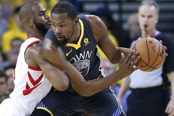 Golden State Warriors forward Kevin Durant (35) is defended by Houston Rockets guard Chris Paul (3) during the first half of Game 4 of the Western Conference Finals at Oracle Arena Tuesday, May 22, 2018 in Oakland. (Michael Ciaglo / Houston Chronicle)