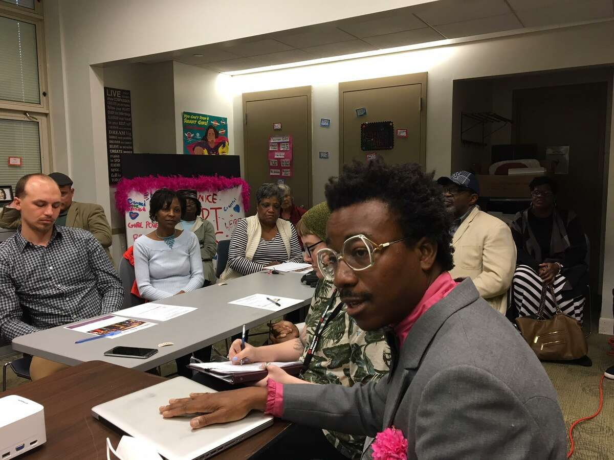 Kwadwo Adae talks to the Newhallville Community Management Team Tuesday about the mural he is designing for the Farmington Canal Trail.