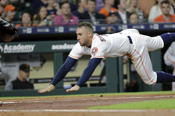 Houston Astros' George Springer dives toward home plate to score during the third inning of a baseball game against the San Francisco Giants on Tuesday, May 22, 2018, in Houston. (AP Photo/David J. Phillip)