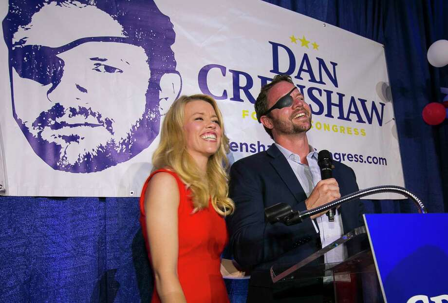 Republican congressional candidate Dan Crenshaw reacts to the crowd with his wife, Tara, as he comes on stage to deliver a victory speech during an election night party at the Cadillac Bar, Tuesday, May 22, 2018 in Houston. Crenshaw was in a run-off with Kevin Roberts for Texas congressional district 2. Photo: Mark Mulligan, Houston Chronicle / © 2018 Houston Chronicle