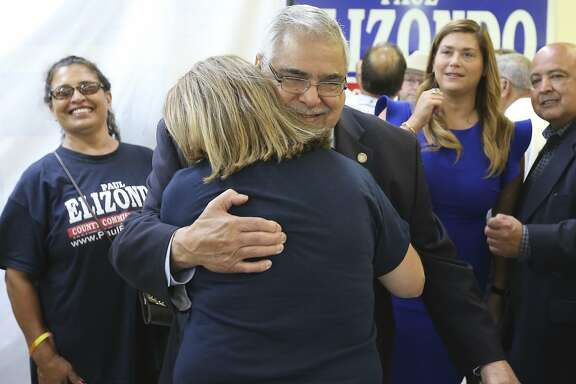 Bexar County Commissioner, Precinct 2 Paul Elizondo gets applause and hugs from supporters after election results start to appear on Tuesday, May 22, 2018. Elizondo faced challenger Queta Rodriguez Scherer for the Democratic nomination. (Kin Man Hui/San Antonio Express-News)