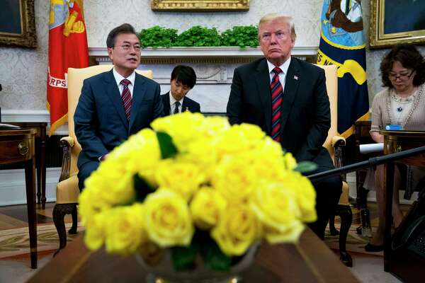 President Donald Trump and President Moon Jae-in of South Korea speak with reporters in the Oval Office of the White House, in Washington, May 22, 2018. Trump welcomed Moon to the Washington Tuesday, as the prospects for Trump's landmark meeting next month with Kim Jong-un of North Korea appeared to have grown a bit cloudy. (Doug Mills/The New York Times)