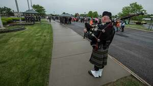 Sgt. Dillard Waring of the NYSP Pipes and Drums plays Amazing Grace at the New York State Thruway headquarters during the annual Memorial Day Ceremony honoring fallen members of Troop T Tuesday May 22, 2018 in Albany, N.Y.  (Skip Dickstein/Times Union)
