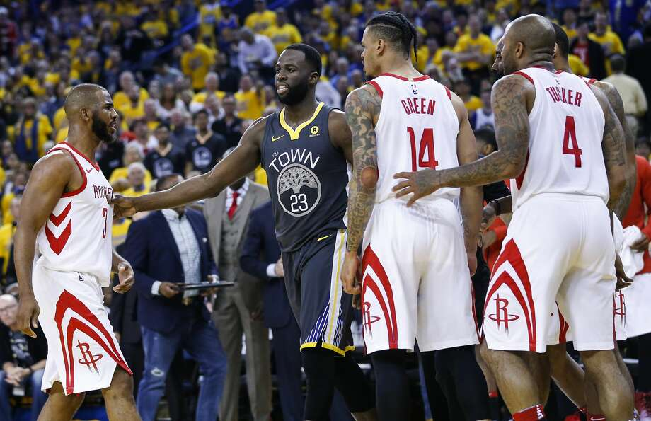 Rockets guards Chris Paul (3) and Gerald Green (14)] and forward PJ Tucker (4) surround Warriors forward Draymond Green (23) during the first half of Game 4 on Tuesday. Photo: Michael Ciaglo/Houston Chronicle