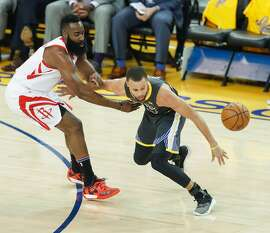 Houston Rockets' James Harden knocks the ball away from Golden State Warriors' Stephen Curry in the first quarter during game 4 of the Western Conference Finals between the Golden State Warriors and the Houston Rockets at Oracle Arena on Tuesday, May 22, 2018 in Oakland, Calif.