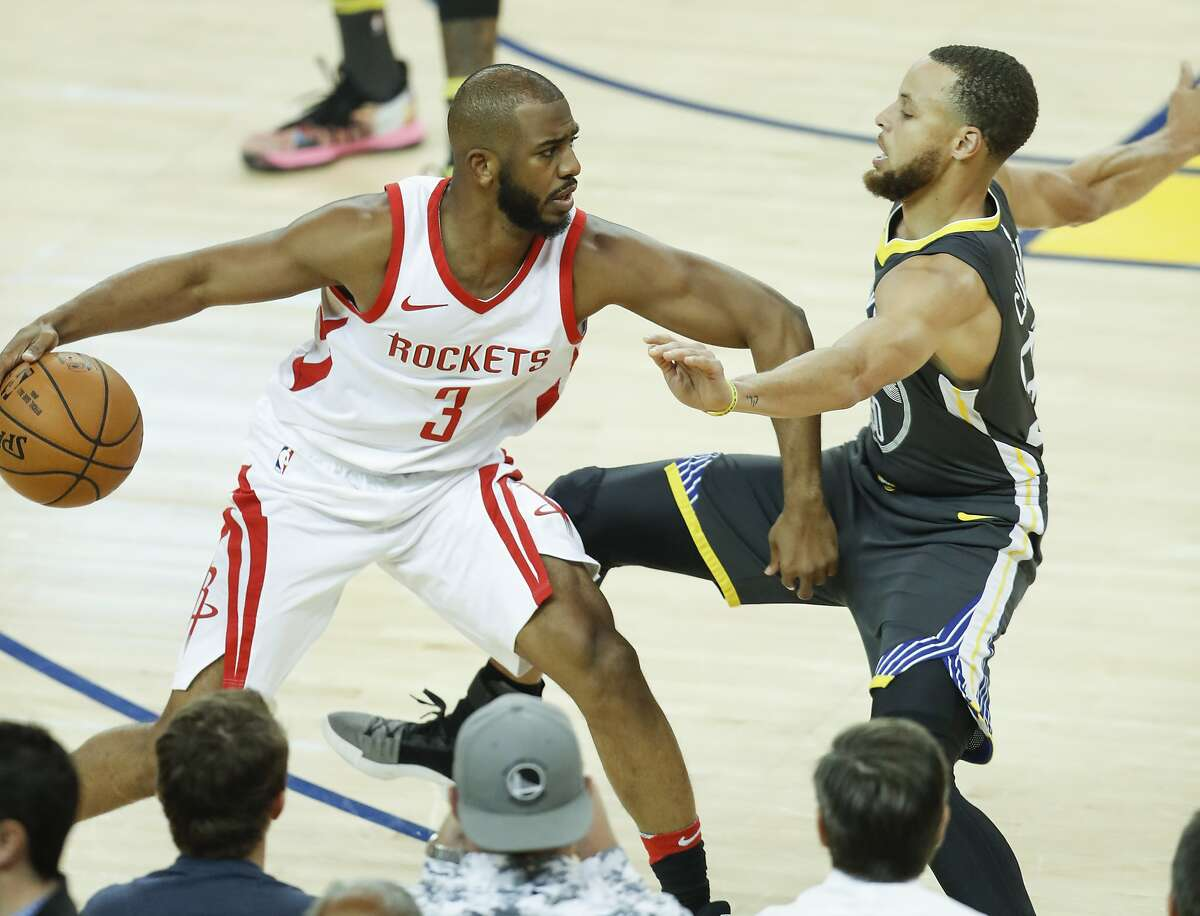 Golden State Warriors' Stephen Curry falls back as Houston Rockets' Chris Paul pushes off in the first quarter during game 4 of the Western Conference Finals between the Golden State Warriors and the Houston Rockets at Oracle Arena on Tuesday, May 22, 2018 in Oakland, Calif.