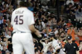 San Francisco Giants' Brandon Crawford (35) runs the bases after hitting a two-run home run off Houston Astros starting pitcher Gerrit Cole (45) during the fifth inning of a baseball game Tuesday, May 22, 2018, in Houston. (AP Photo/David J. Phillip)