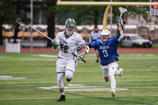 Shenendehowa's Duncan Hill move's past Shaker's Andrew O'Connor during the men's lacrosse home game at Shenendehowa Tuesday, May 22nd, 2018. Photo by Eric Jenks, for the Times Union