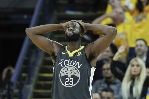 Golden State Warriors' Draymond Green looks up at the scoreboard early in the third quarter during game 4 of the Western Conference Finals between the Golden State Warriors and the Houston Rockets at Oracle Arena on Tuesday, May 22, 2018 in Oakland, Calif.