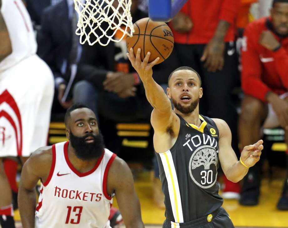 Golden State Warriors' Stephen Curry scores past Houston Rockets' James Harden in 3rd quarter during Game 4 of NBA Western Conference Finals at Oracle Arena in Oakland, CA on Tuesday, May 22, 2018. Photo: Scott Strazzante / The Chronicle / San Francisco Chronicle