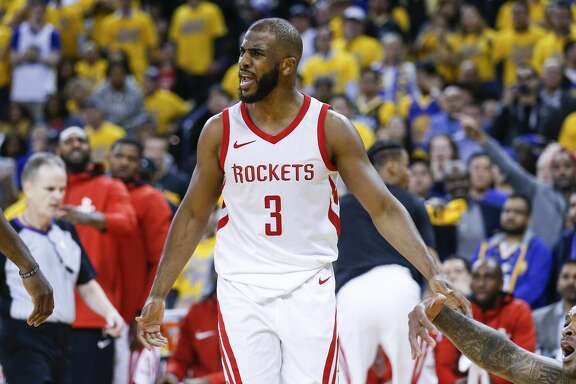 Houston Rockets guard Chris Paul (3), James Harden and P.J. Tucker celebrate a 3-pointer by Paul against the Golden State Warriors during the second half of Game 4 of the Western Conference Finals at Oracle Arena Tuesday, May 22, 2018 in Oakland. (Michael Ciaglo / Houston Chronicle)
