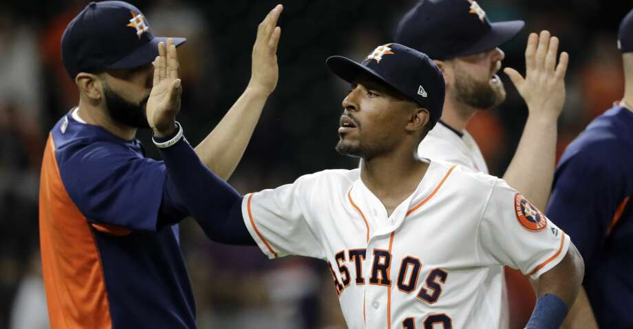 Houston Astros' Tony Kemp (18) celebrates with teammates after a baseball game against the San Francisco Giants on Tuesday, May 22, 2018, in Houston. The Astros won 11-2. (AP Photo/David J. Phillip) Photo: David J. Phillip/Associated Press