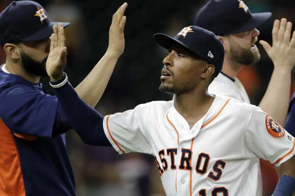 Houston Astros' Tony Kemp (18) celebrates with teammates after a baseball game against the San Francisco Giants on Tuesday, May 22, 2018, in Houston. The Astros won 11-2. (AP Photo/David J. Phillip)
