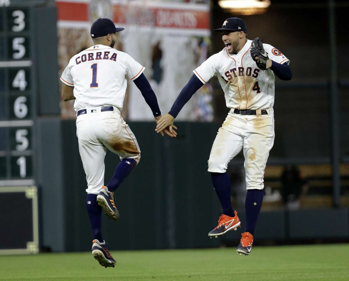 Houston Astros' Carlos Correa (1) celebrates with George Springer (4) after a baseball game against the San Francisco Giants on Tuesday, May 22, 2018, in Houston. The Astros won 11-2. (AP Photo/David J. Phillip)