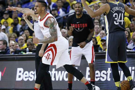 Rockets guard Gerald Green, left, celebrates in front of Warriors guard Shaun Livingston as the clock runs out on Game 4 of the Western Conference Finals.