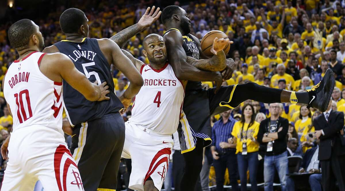Houston Rockets forward PJ Tucker (4) fights for a rebound with Golden State Warriors forward Draymond Green (23) during the second half of Game 4 of the Western Conference Finals at Oracle Arena Tuesday, May 22, 2018 in Oakland. (Michael Ciaglo / Houston Chronicle)