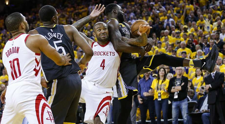 Forward P.J. Tucker (4) pulled down a game-high 16 rebounds Tuesday as the Rockets dominated the boards during the fourth quarter of their Game 4 comeback victory over the Warriors. Photo: Michael Ciaglo/Houston Chronicle