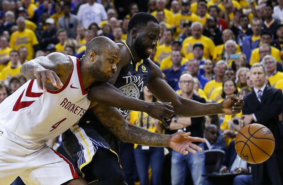 Houston Rockets forward PJ Tucker (4) and Golden State Warriors forward Draymond Green (23) go after a loose ball during the second half of Game 4 of the Western Conference Finals at Oracle Arena Tuesday, May 22, 2018 in Oakland. (Michael Ciaglo / Houston Chronicle) Photo: Michael Ciaglo/Houston Chronicle