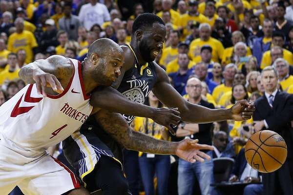 Houston Rockets forward PJ Tucker (4) and Golden State Warriors forward Draymond Green (23) go after a loose ball during the second half of Game 4 of the Western Conference Finals at Oracle Arena Tuesday, May 22, 2018 in Oakland. (Michael Ciaglo / Houston Chronicle)