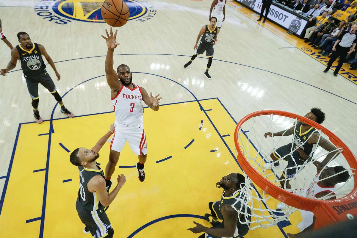 Houston Rockets' Chris Paul shoots over Golden State Warriors' Stephen Curry in the first half during game 4 of the Western Conference Finals between the Golden State Warriors and the Houston Rockets at Oracle Arena on Wednesday, May 23, 2018 in Oakland, Calif.