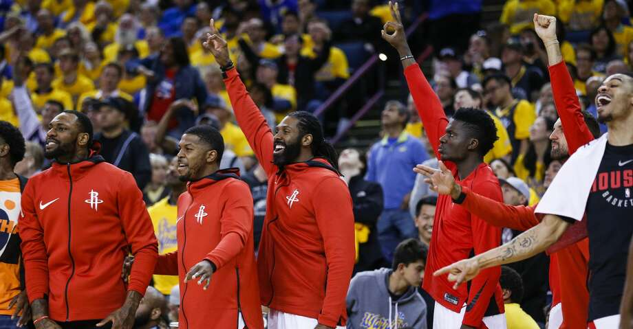 The Houston Rockets bench reacts to the Rockets scoring a 3-pointer against the Golden State Warriors during the first half of Game 4 of the Western Conference Finals at Oracle Arena Tuesday, May 22, 2018 in Oakland. (Michael Ciaglo / Houston Chronicle) Photo: Michael Ciaglo/Houston Chronicle