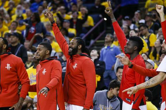 The Houston Rockets bench reacts to the Rockets scoring a 3-pointer against the Golden State Warriors during the first half of Game 4 of the Western Conference Finals at Oracle Arena Tuesday, May 22, 2018 in Oakland. (Michael Ciaglo / Houston Chronicle)