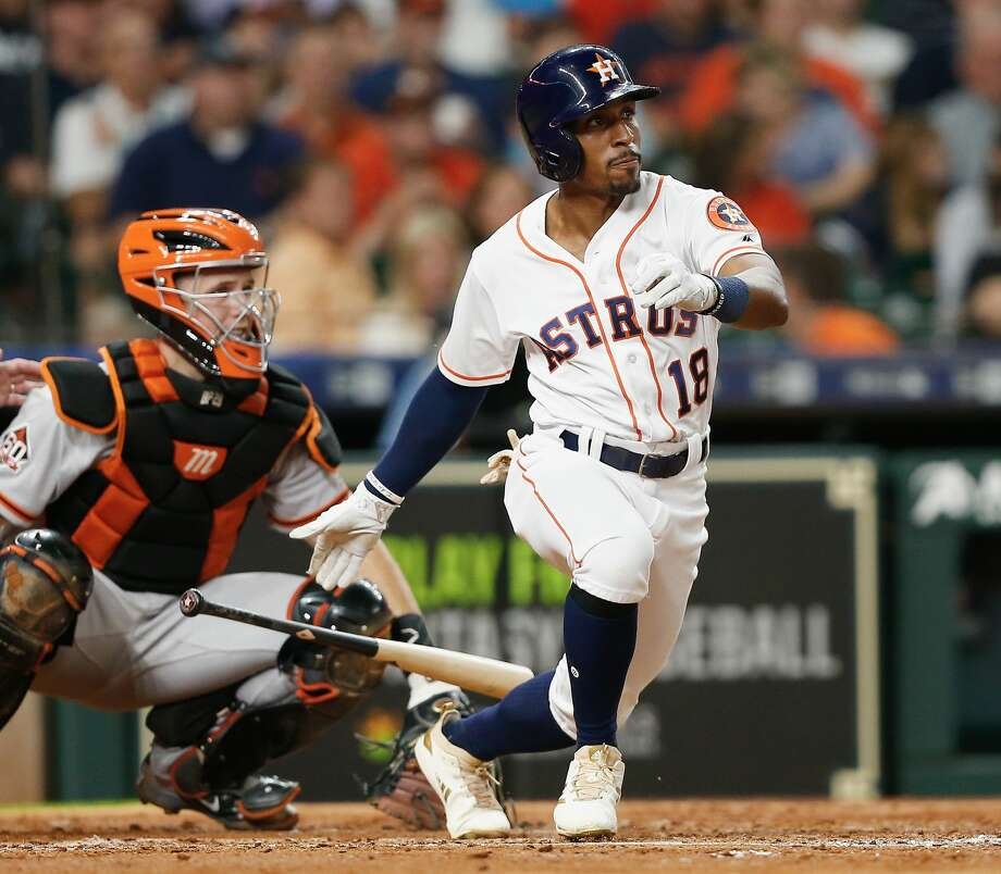 HOUSTON, TX - MAY 22:  Tony Kemp #18 of the Houston Astros singles in two runs in the fourth inning as Buster Posey #28 of the San Francisco Giants looks on at Minute Maid Park on May 22, 2018 in Houston, Texas.  (Photo by Bob Levey/Getty Images) Photo: Bob Levey/Getty Images