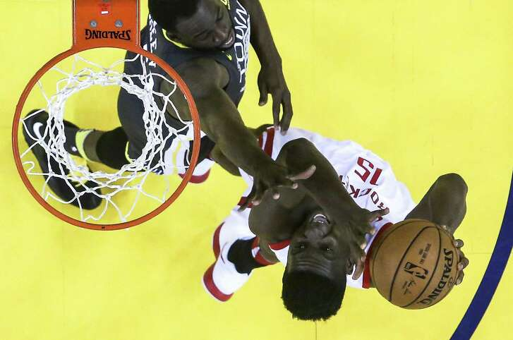 Houston Rockets center Clint Capela (15) takes a shot against Golden State Warriors forward Draymond Green (23) during the second half of Game 4 of the Western Conference Finals at Oracle Arena Tuesday, May 22, 2018 in Oakland. (Michael Ciaglo / Houston Chronicle)