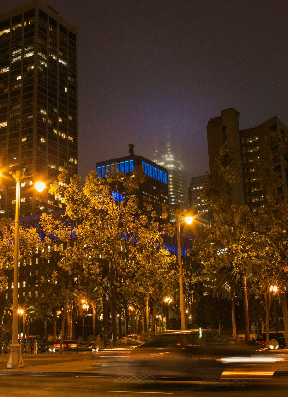 Fog enshrouds the Salesforce Tower on Tuesday, obscuring the new light installment.
