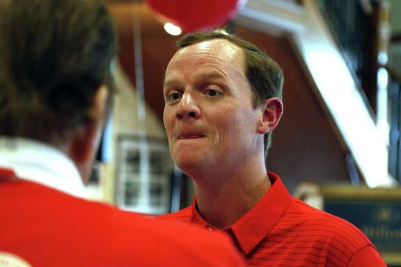 Houston football coach Major Applewhite mingled with supporters Tuesday.
