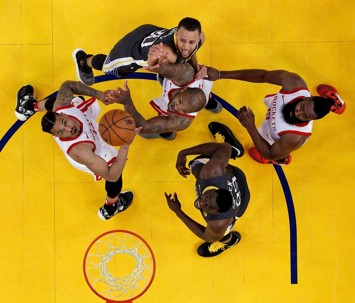 Players watch as Stephen Curry's (30) shot goes toward the basket in the first half as the Golden State Warriors played the Houston Rockets in Game 4 of the Western Conference Finals at Oracle Arena in Oakland, Calif., on Tuesday, May 22, 2018. Houston defeated the Warriors 95-92