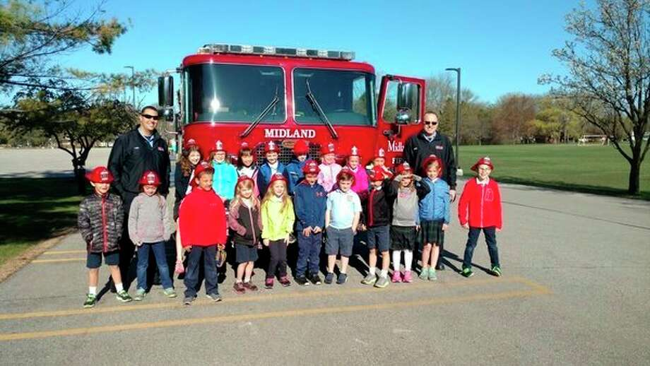Students in kindergarten, first and second grade at Blessed Sacrament Catholic School in Midland participated in a Fire Safety Education program this school year. The Midland Fire Department covered a different topic each month. In addition to learning stop, drop and roll, students learned about smoke detectors, poisons, water safety, cooking safety, bike safety and planning an escape route. (Photo provided)