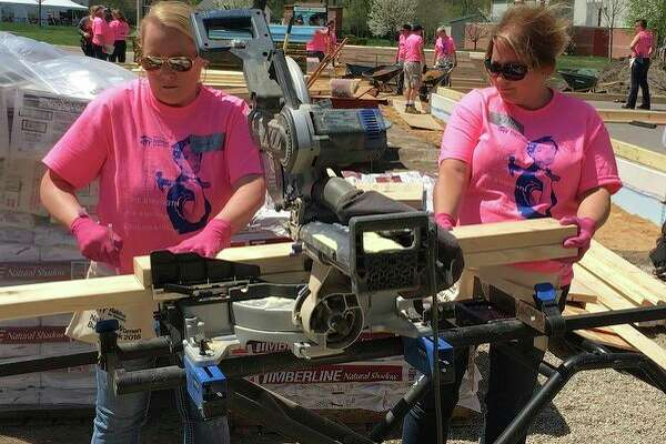 Dow Chemical Employees' Credit Union consumer loan underwriter Sandy Greff and onboarding specialist Katie Goretcki participate in Midland County Habitat for Humanity's Women Build Week. (Photo provided)