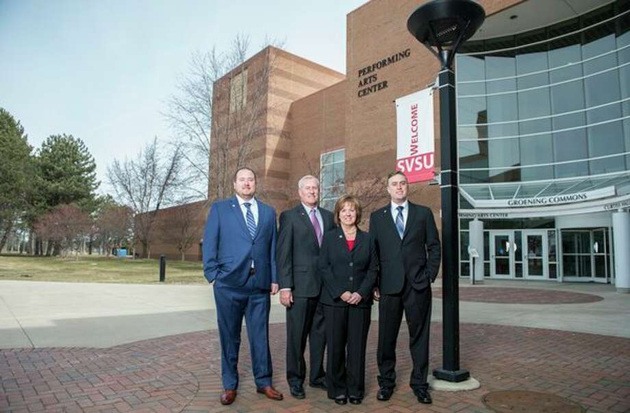 Eric, Scott, Nancy and Ryan Carmona are pictured near the site on campus where Saginaw Valley State University will construct a 38,500-square-foot building addition to house the Scott L. Carmona College of Business and Management. The Carmona family pledged the lead gift for a fundraising campaign to support the project. (Photo provided/SVSU)